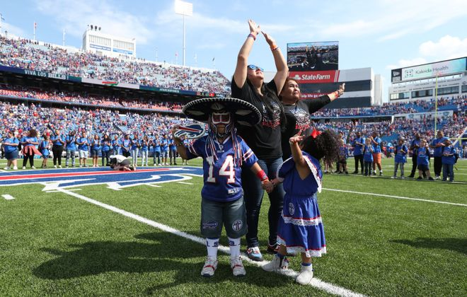 "The family of Ezra ""Pancho Billa"" Castro watches a special tribute to Castro before the start of the Sept. 23, 2019, game at New Era Field. (James P. McCoy/News file photo)"
