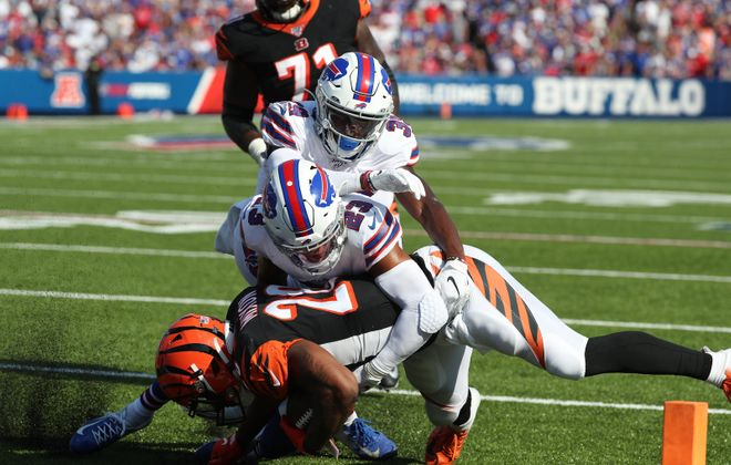 Bills safety Micah Hyde tackles Bengals running back Joe Mixon in Week 3. (James P. McCoy/Buffalo News)