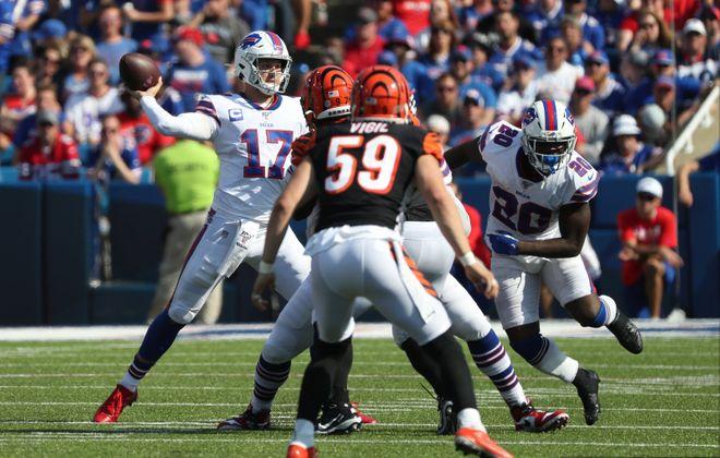 Bills quarterback Josh Allen throws a pass in the fourth quarter against the Bengals  (James P. McCoy/Buffalo News)