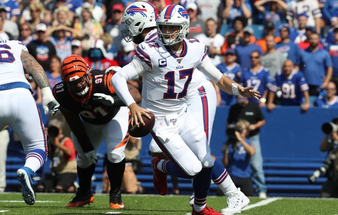 Bills quarterback Josh Allen rushes with the ball  in the first quarter at New Era Field. (James P. McCoy/Buffalo News)