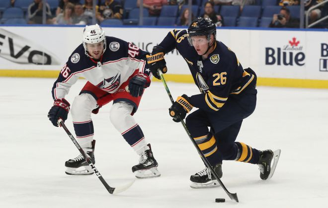 Sabres defenseman Rasmus Dahlin battles Columbus Blue Jackets defenseman Dean Kukan for the puck in the first period at KeyBank Center on Wednesday, Sept. 25, 2019. (James P. McCoy/Buffalo News)