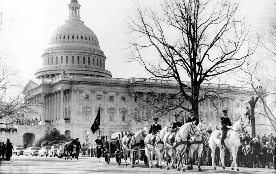 A horse-drawn caisson carrying the flag-draped casket of President John F. Kennedy moves out of the Capitol plaza Nov. 25, 1963, en route to St. Matthew's Cathedral for funeral services. Kennedy's assassination is one of five subjects worthy of the efforts of documentarian Ken Burns.
