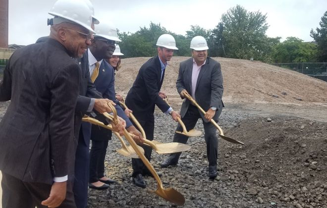 Buffalo Mayor Byron W. Brown and other dignitaries at the groundbreaking for Ciminelli Real Estate Corp.'s West End townhouse project in the Waterfront Village. (Jonathan D. Epstein/Buffalo News)
