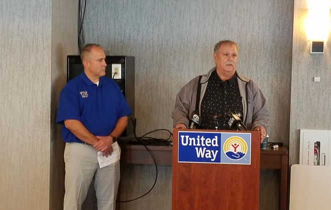 Michael Sigurdson, left, and Marcus Latham, co-chairmen of the 2019 United Way of Greater Niagara campaign, speak at a news conference in Niagara Falls Sept. 13, 2019. (Thomas J. Prohaska/Buffalo News)