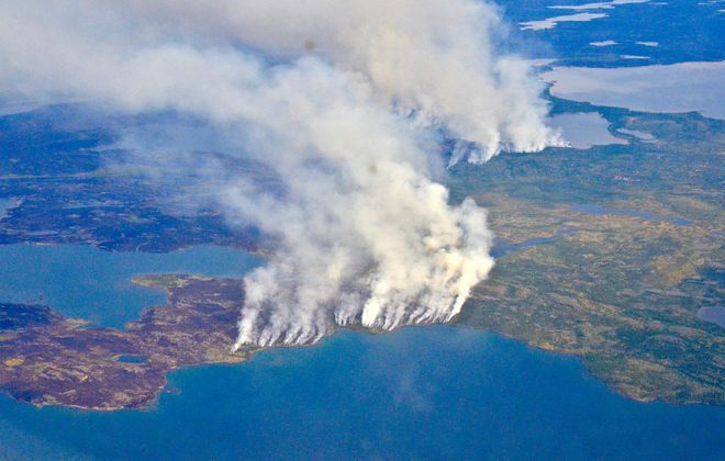 In 2014, megafires in Canada's Northwest Territories scorched more than 7 million acres of forest, releasing half as much carbon back into the atmosphere as all the plants and trees in Canada typically absorb in an entire year. (Photo courtesy of NASA/Peter Griffith)