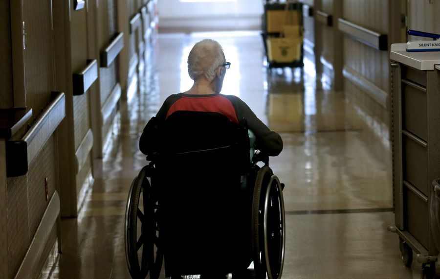 A resident makes his way back to his room at Absolut at Aurora Park nursing home in East Aurora in 2018. (Robert Kirkham/News file photo)