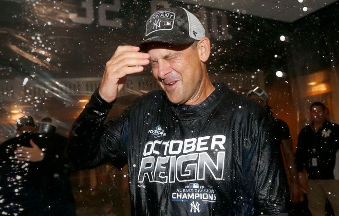 Yankees manager Aaron Boone gets the champagne shower after his team clinched the AL East Thursday night. (Getty Images)