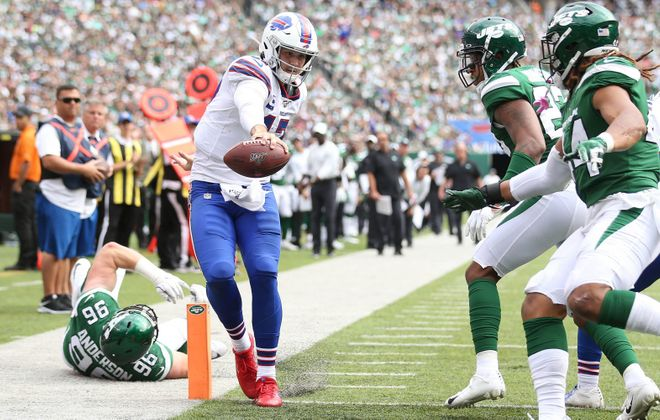 Bills quarterback Josh Allen scores on a 3-yard touchdown run in the fourth quarter Sunday against the Jets. (Getty Images)