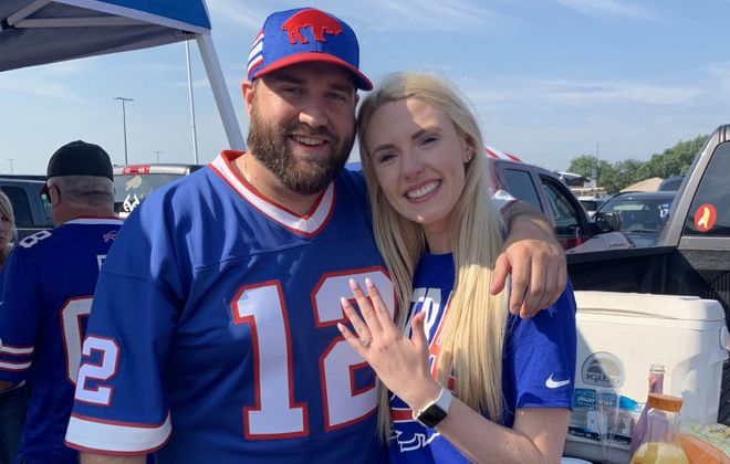 Eric Bish and Angela Collins after they got engaged Sunday outside New Era Field. (Photo courtesy of Eric Bish)