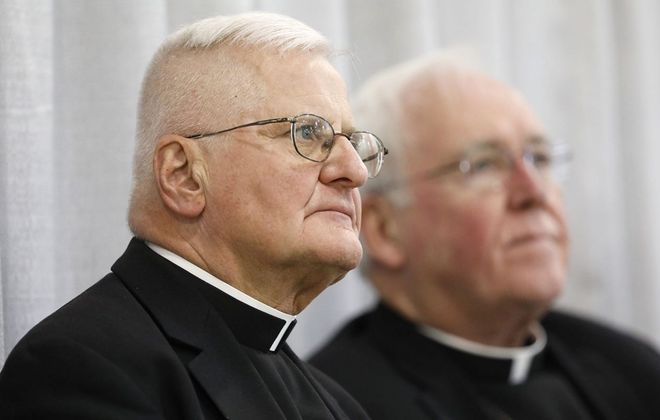 Auxiliary Bishop Edward Grosz, left, pictured in 2018 with retired Bishop Richard J. Malone. (Derek Gee/News file photo)