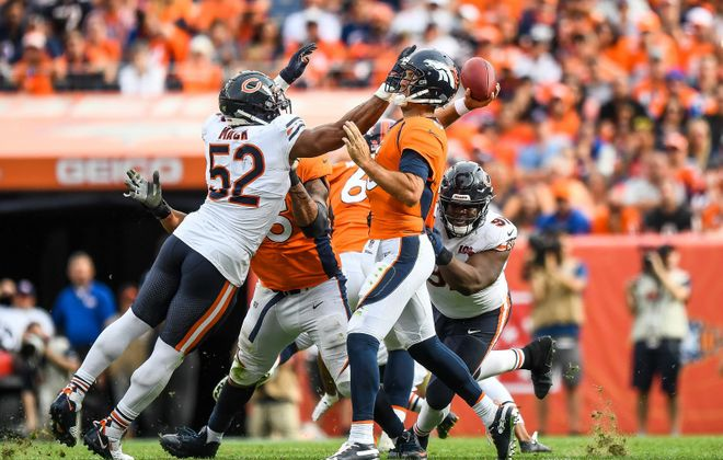 Bears defensive end Khalil Mack pressures Broncos quarterback Joe Flacco during Chicago's Week 2 victory. (Getty Images)