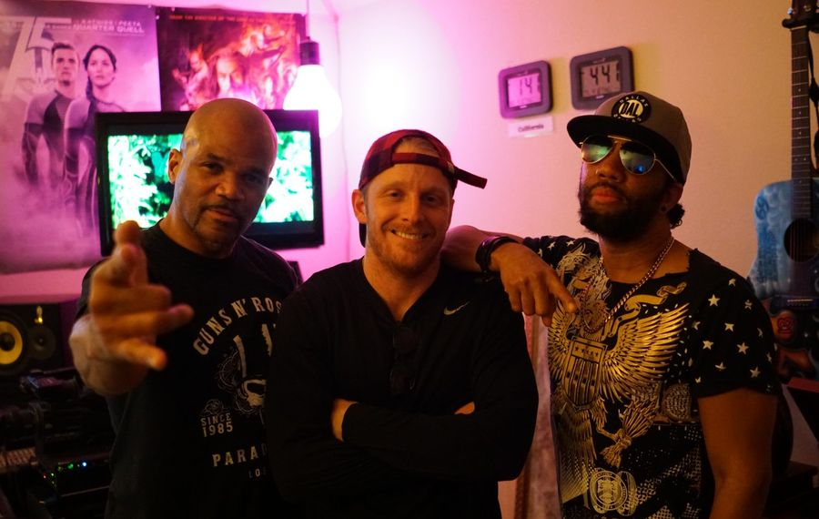 """Buffalo Bills wide receiver Cole Beasley (center) and hip-hop icon Darryl McDaniels, left, better known as DMC of the group Run-DMC, recorded a song called """"Adrenaline Junkie,"""" which was produced by Victor """"Phazz"""" Clark, right."""