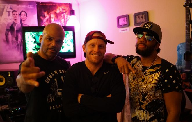 "Buffalo Bills wide receiver Cole Beasley (center) and hip-hop icon Darryl McDaniels, left, better known as DMC of the group Run-DMC, recorded a song called ""Adrenaline Junkie,"" which was produced by Victor ""Phazz"" Clark, right."