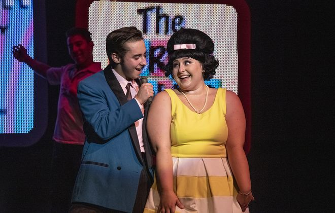"""Jamil Kassem-Lopez as Link and Maeghan McDonald as Tracy Turnblad in the Kavinoky Theatre's """"Hairspray."""" (Photo by Gene Witkowski)"""