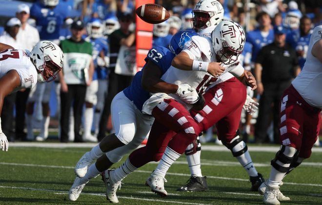 Bulls defensive end Ledarius Mack (52) forces a fumble by Temple Owls quarterback Anthony Russo in the Sept. 21, 2019, game. (James P. McCoy/News file photo)