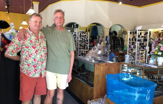 Alan Walaski-Miller, left, and his husband, James, inside Miss Josie's, their antique and vintage clothing store in Kenmore that is closing after 14 years. (Stephen T. Watson/Buffalo News)