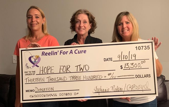 Patty Murray, center, with Hope for Two accepts a check for $13,300 from Reelin' for a Cure organizers Stephanie Pierleoni, right, and Renee Boyd. (Photo courtesy of Stephanie Pierleoni)