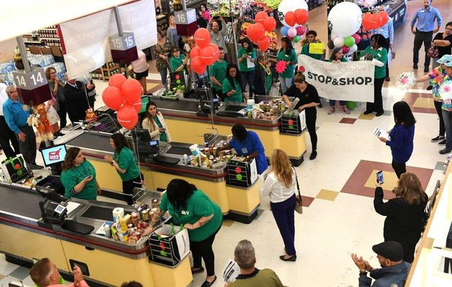 Contestants compete to see who can bag groceries the fastest and the best. (Contributed photo)