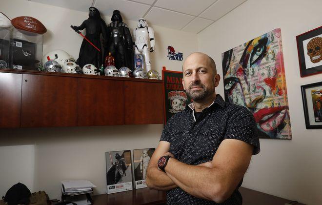 Chris Passarell's office includes footballs autographed by Brian Moorman, his former next door neighbor, and Vinny Testaverde. (Derek Gee/Buffalo News)