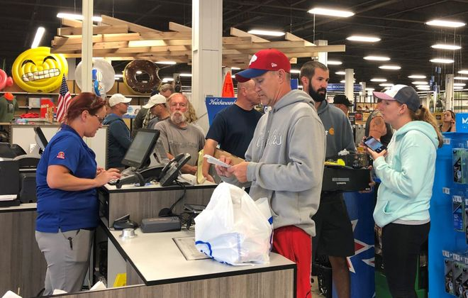Customers line up to grab merchandise at a 40% discount at Gander Outdoors on Young Street in Tonawanda. (Samantha Christmann/Buffalo News)