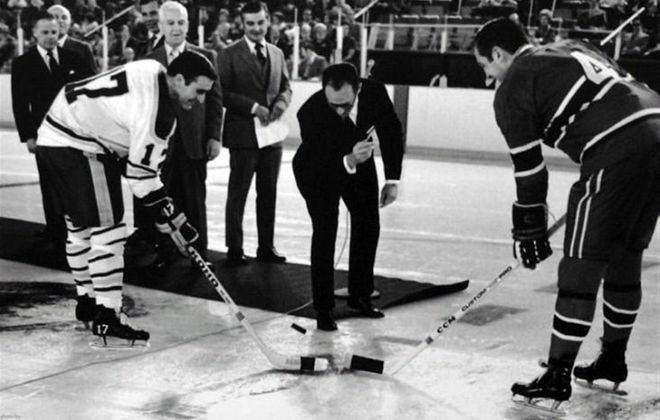 Floyd Smith, left, and Montreal's Jean Beliveau take the ceremonial faceoff before the Sabres' first home game in the Aud on Oct. 15, 1970. (News file photo)