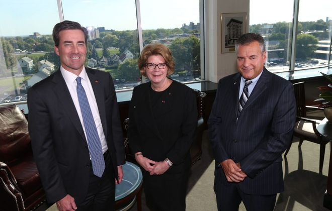 Christopher Gorman, left, will be KeyBank's next chairman and CEO, after Beth Mooney, center, retires. At right is Gary Quenneville, regional sales executive and Buffalo market president. (Sharon Cantillon/News file photo)