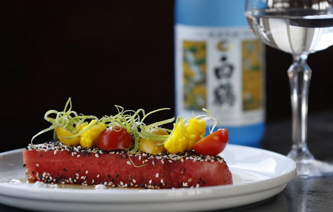 """Roost's """"Watermelon With Flavors of Japan"""" is a hunk of watermelon compressed in soy and served extra cold with pickled daikon, pickled ginger, cubes of coconut jelly, baby white radishes and sesame powder. (Sharon Cantillon/Buffalo News)"""