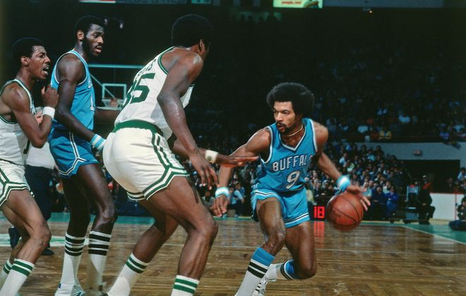 Randy Smith (right) and Bob McAdoo take on the Celtics for the old Buffalo Braves.