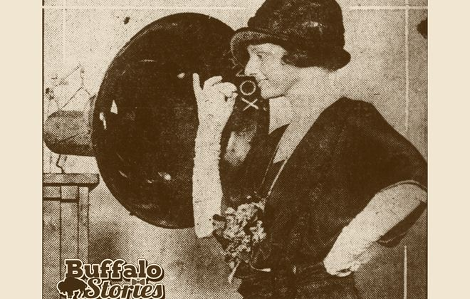 Edna Zahn approaches the microphone at Buffalo's WWT studios on West Mohawk Street in 1922.