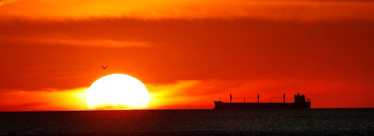 The sun sets on Lake Ontario as a ship passes by Sept. 19. (Sharon Cantillon/News file photo)