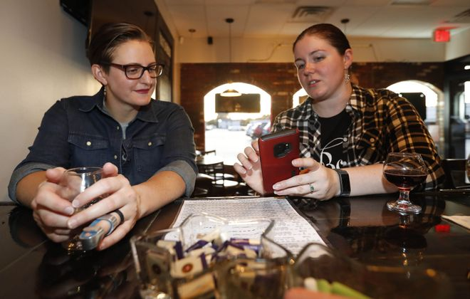 Bliss Lillis of Depew and Shannon Pelland of the Town of Tonawanda talk over glasses of mead at Queen City Meadery in West Seneca. (Sharon Cantillon/Buffalo News)