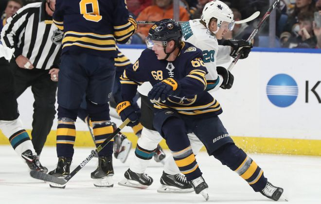 Buffalo Sabres right wing Victor Olofsson (68) battles San Jose Sharks left wing Marcus Sorensen (20) for the puck during the first period at KeyBank Center on Oct. 22, 2019.  (James P. McCoy/Buffalo News)