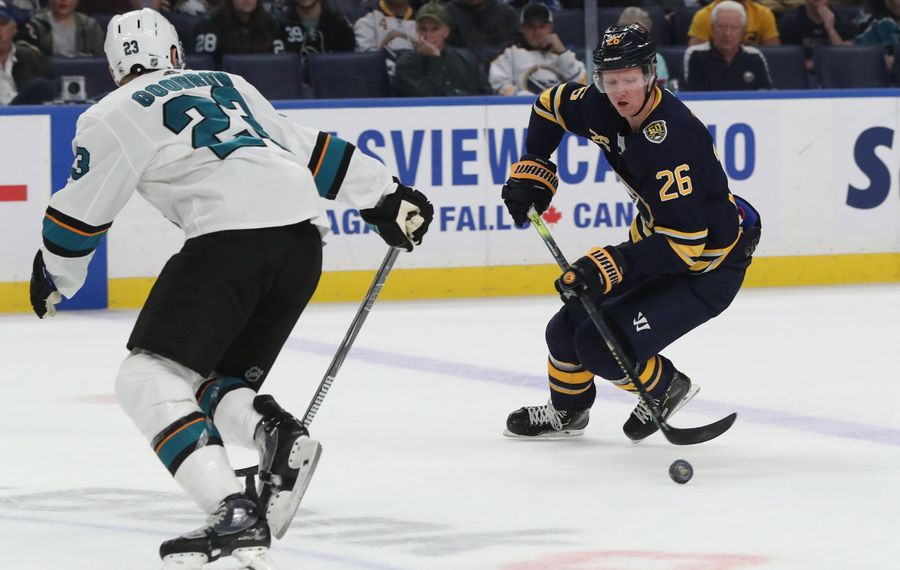 Buffalo Sabres defenseman Rasmus Dahlin (26) battles San Jose Sharks center Barclay Goodrow (23) for the puck in the first period at Key Bank Center in Buffalo, NY on Tuesday, Oct. 22, 2019.  James P. McCoy/Buffalo News