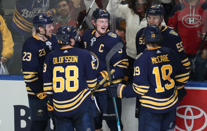 Buffalo Sabres center Jack Eichel (9) celebrates his second goal of the game with Buffalo Sabres defenseman Rasmus Ristolainen (55) in the second period at Key Bank Center in Buffalo, NY on Wednesday, Oct. 9, 2019.  James P. McCoy/Buffalo News