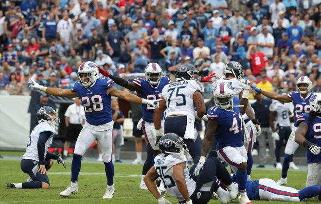 Bills strong safety Kurt Coleman and the rest of special teams celebrate after Tennessee Titans kicker Cairo Santos missed a field goal in the fourth quarter. (James P. McCoy/Buffalo News)