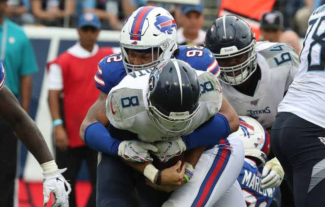 Bills rookie defensive end Darryl Johnson Jr. got his first career sack Sunday on Titans quarterback Marcus Mariota. (James P. McCoy/Buffalo News