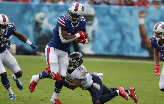 Buffalo Bills running back T.J. Yeldon (22) rushes for a first down over Tennessee Titans cornerback Malcolm Butler (21) in the first quarter at Nissan Stadium in Nashville, TN on Sunday, Oct. 6, 2019.  James P. McCoy/Buffalo News