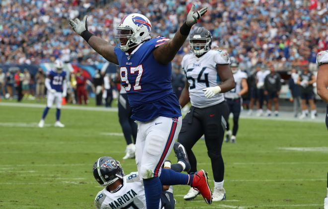 Bills defensive tackle Jordan Phillips sacks Tennessee Titans quarterback Marcus Mariota. (James P. McCoy/Buffalo News)