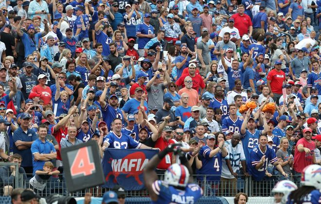 These may be the only Buffalo Bills fans who didn't watch the game against the Tennessee Titans on TV Sunday. But they had a good reason: They were inside Nissan Stadium in Nashville. (James P. McCoy/Buffalo News)