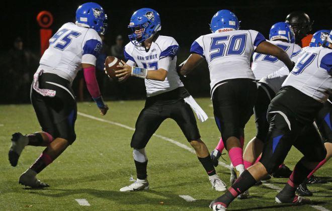 Kenmore West quarterback QB Zach Boyes drops back to hand off against McKinley. (Robert Kirkham/Buffalo News)