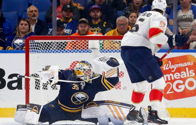 Buffalo Sabres goaltender Linus Ullmark (35) makes a save on Florida Panthers defenseman Aaron Ekblad (5) in the first period at the KeyBank Center in Buffalo Friday, Oct. 11, 2019.              (Mark Mulville/Buffalo News)