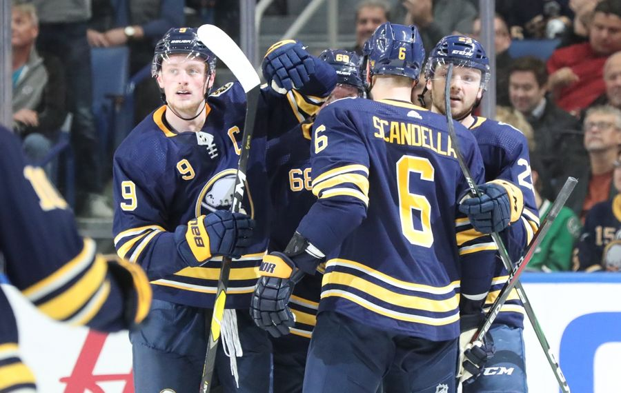 Buffalo Sabres center Sam Reinhart (23) celebrates a goal with right wing Victor Olofsson (68), center Jack Eichel (9) and defenseman Marco Scandella (6) at KeyBank Center on Monday, Oct. 14, 2019. (James P. McCoy/Buffalo News)
