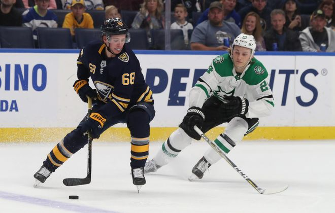 Buffalo Sabres right wing Victor Olofsson (68) battles Dallas Stars left wing Roope Hintz (24) for the puck in the second period at Key Bank Center in Buffalo, NY on Monday, Oct. 14, 2019.  James P. McCoy/Buffalo News
