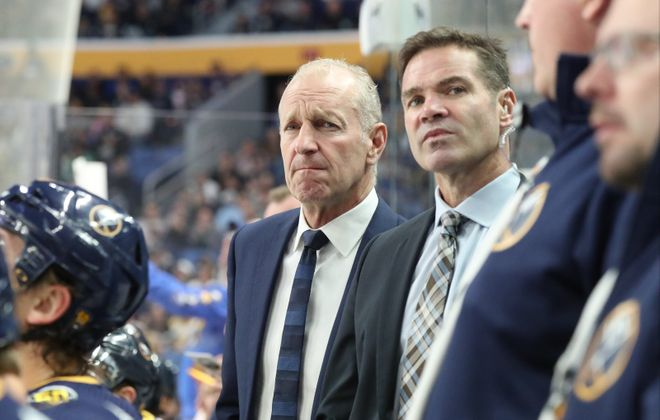 Rochester coach Chris Taylor, right, has been coaching on the Sabres bench with Ralph Krueger in the absence of assistant Don Granato. (James P. McCoy/News file photo)