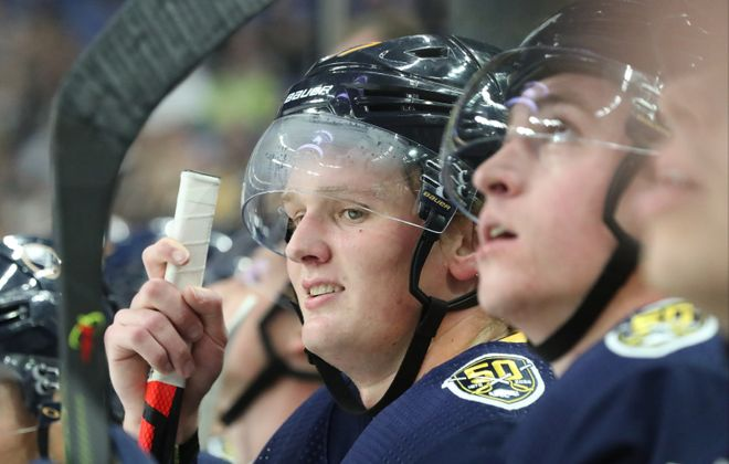 Sabres center Casey Mittelstadt looks up at the scoreboard while on the bench in the first period at Key Bank Center. (James P. McCoy/Buffalo News)