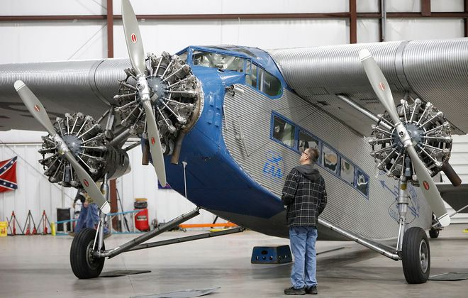 Mike Sadowy of Clarence Center examines the EAA's touring Ford Tri-Motor aircraft as it is parked in a hangar at the Buffalo-Lancaster Regional Airport on Thursday, Oct. 3, 2019. (Derek Gee/Buffalo News)