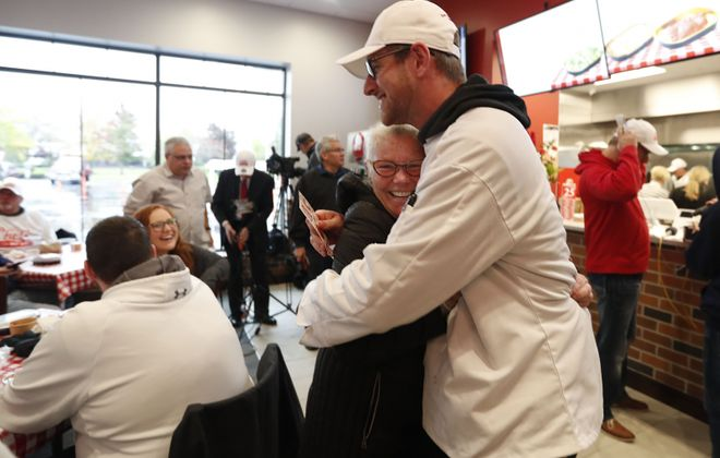 Scott Mariglia, who was the first in line at 7:30 p.m. on Wednesday, is greeted by mother-in-law Patricia Firth of Grand Island who made him a special Chef's chef jacket for the occasion. (Sharon Cantillon/Buffalo News)