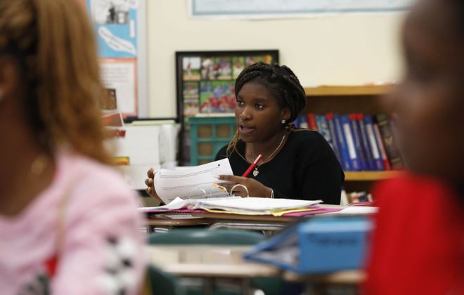 Student Tahmera Cole  participates in class at Middle Early College High School, where those who receive tuition assistance funding for college graduate in four years in higher percentages than in any other high school in Erie County. (Sharon Cantillon/Buffalo News)