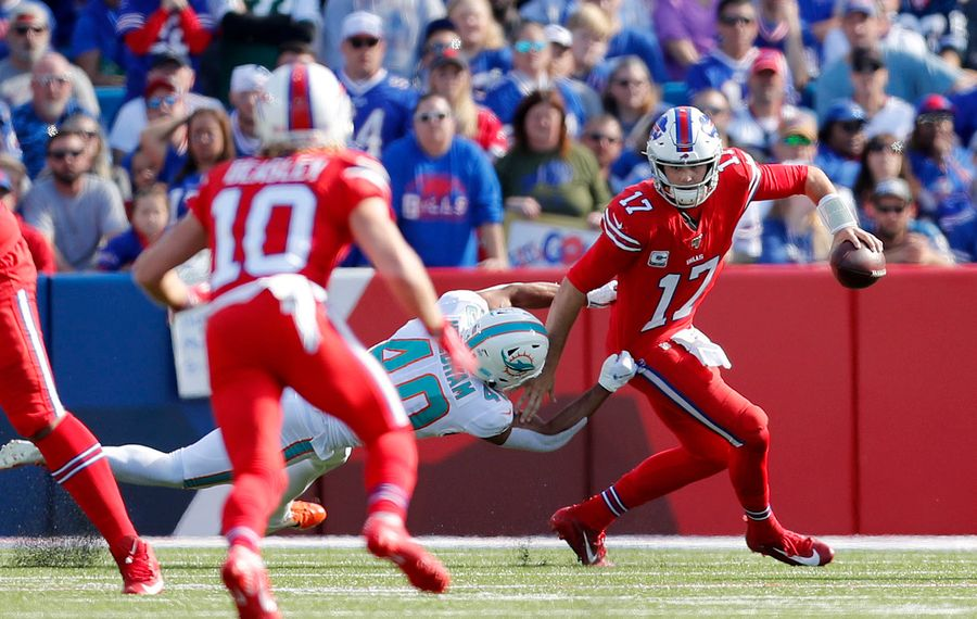 Bills quarterback Josh Allen scrambles away from Dolphins defensive back Nik Needham in the second quarter at New Era Field.   (Mark Mulville/Buffalo News)