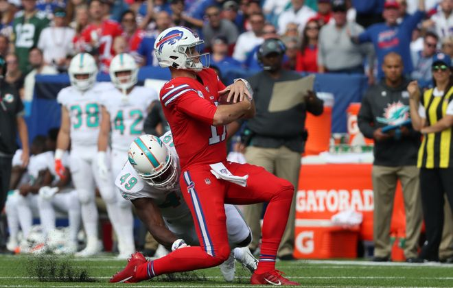 Buffalo Bills quarterback Josh Allen (17) rushes for a first down against Miami Dolphins linebacker Sam Eguavoen (49) in the first quarter at New Era Field in Orchard Park, NY on Sunday, Oct. 20, 2019.  James P. McCoy/Buffalo News